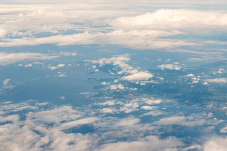 blu sky: Cloudscape view with mountain above white clouds and blue sky from airplane Stock Photo