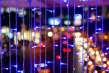 Defocused of beautiful urban abstract texture bokeh city lights and traffic jams in the background with blurring lights in the city
