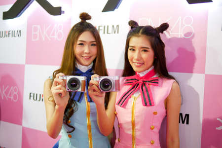 BANGKOK, THAILAND - FEBRUARY 20, 2018: Pretty girls are showing Fujifilm X-A5, the latest mirrorless camera X-A Series for entry customer segment from Fujifilm (Thailand) Ltd. that has been unveiled at CentralWorld shopping mall in Bangkok Thailand.