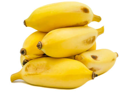Ripe cultivated bananas with isolated on a white background, there are almost always seedless (parthenocarpic) and hence sterile 免版税图像