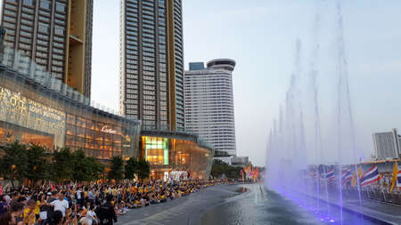 BANGKOK, THAILAND - MAY 6, 2019: Many people are watching the light and sound show, shopping mall, Siam icon, in the evening, happily amidst the backdrop of rivers and skyscrapers.