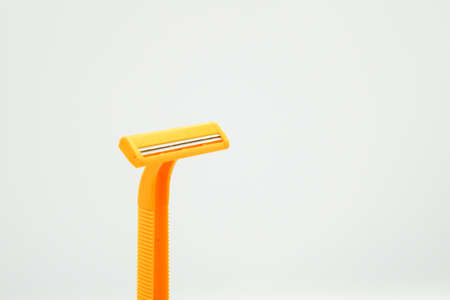 Shaving razor blades for men or women in yellow color, the object is isolated on white background Imagens