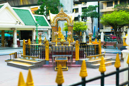 BANGKOK, THAILAND - APRIL 5, 2020: Erawan Shrine (Thao Maha Phrom Shrine) is located at the Ratchaprasong Intersection has been temporarily closed due to COVID-19 and lockdown Bangkok Sajtókép