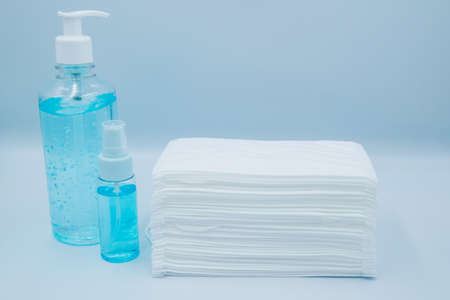 Medical equipment set that consist of face mask, alcohol gel and cleansing gel that help to protect mask cover the mouth and nose from virus, bacteria, dust or other pollution. the mask is taken on  mask on isolated light blue background. 版權商用圖片