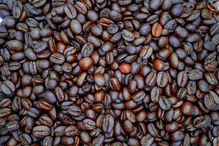 Many brown roasted coffee beans background Stock fotó