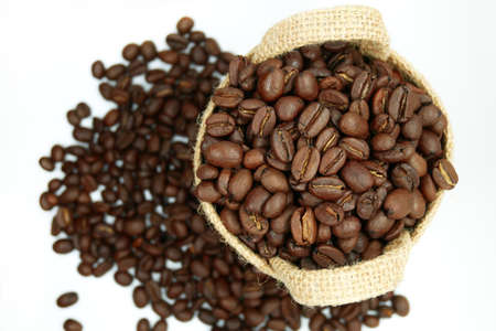coffee beans in a vintage sack on isolated white background, top view 版權商用圖片