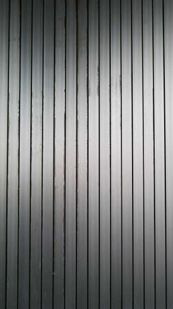 White vintage corrugated metal or zinc texture surface or galvanize steel in the vertical line background or texture