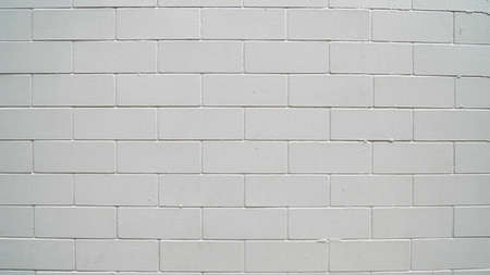 Traditonal old white brick wall texture for background and architecture