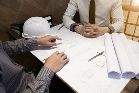 The engineer and partner are discussing about construction plan at the office, Vintage tone, Engineering concept.