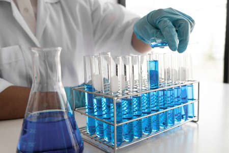 Female scientist are experimenting in the laboratory, science concept, virus, chemical.