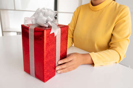 the woman holding a giftbox, Birthday, Christmas, Valentine day concept.