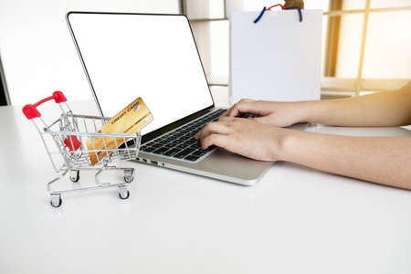Closeup hand of women is using computer notebook for shopping online.