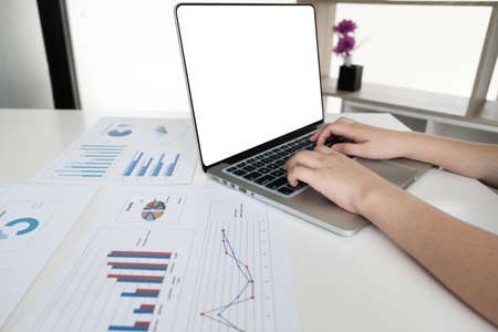 Businessman is working with computer notebook for analyze marketing strategy from the sell performance graph in the office room, Finance and accounting concept.