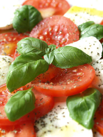 Caprese - mozzarella with tomatoes, basil and herbs. photo