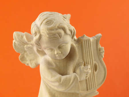 Christmas wooden angel playing on a harp photo