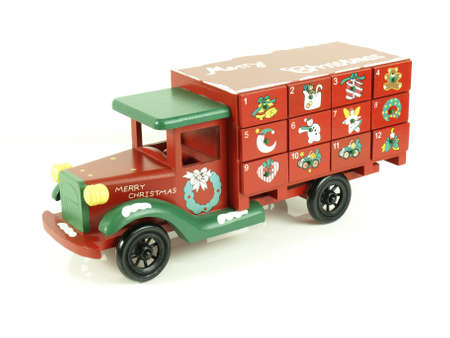 Christmas advent calendar wooden toy car on isolated background photo