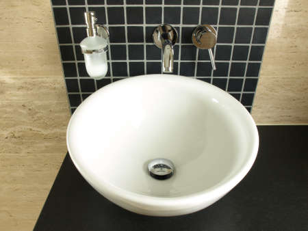 bowl sink: Vessel porcelaine sink on a black granite countertop