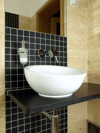 Luxurious bathroom with stone mosaic and granite countertop photo