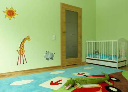 wall clouds: Children jungle themed bedroom with a baby cot.