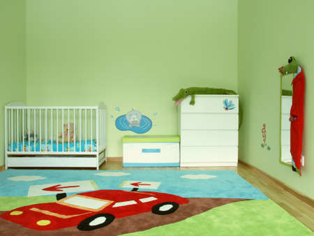 chest of drawers: Baby colourful bedroom with a carpet Stock Photo