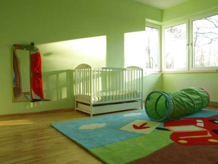 Green baby bedroom with a play tunnel Stock Photo