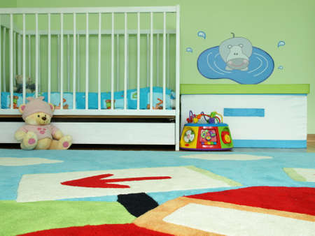 playschool: Closeup of a baby bedroom with a cot