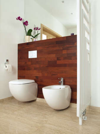 Luxury bathroom with exotic wood and travertine photo