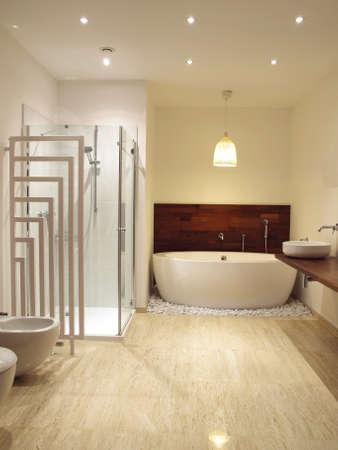 en suite: Fee standing bath in a contemporary bathroom