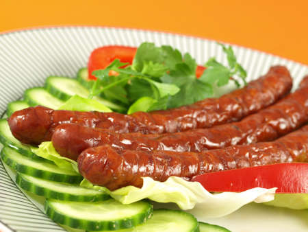 Close-up of well cooked sausages  photo