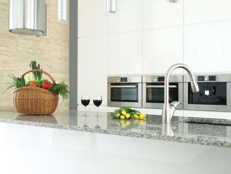 kitchen counter top: Modern kitchen interior with vegetables, glasses of wine and flowers