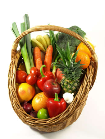Basket with colorful vegetables and fruits on isolated background  photo