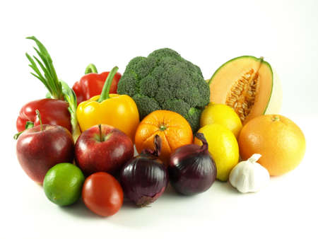 Close-up of fruits and vegetables on white background photo