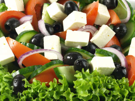 Greek salad with tomatoes and feta as background photo