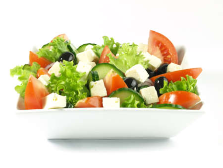 salad dressing: Close-up of greek salad on isolated salad