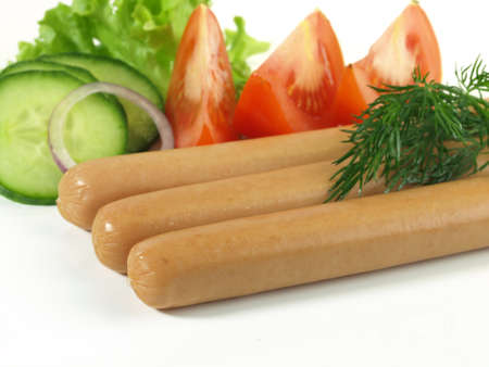 Appetizing sausages with tomato and cucumber  photo