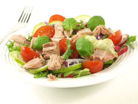 tuna: Tuna salad with different vegetables on isolated background