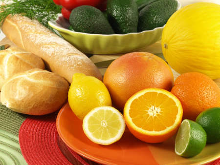 Closeup of juicy oranges and fresh rolls with avocados in a background photo