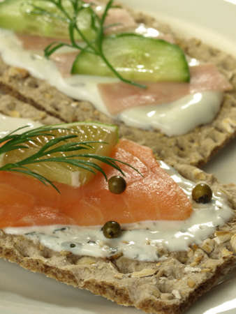 Diet slices of bread with salmon and cucumber and ham in a garlic sauce photo