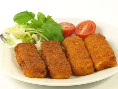 Four fish fingers for dinner with tomato and salad Stock Photo - 12655604