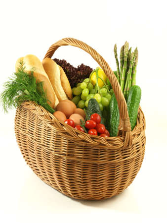 egg roll: Wicker basket full of vegetables, fruits and bread. Stock Photo
