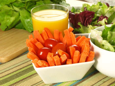 Carrot sticks with lwttuce and orange juice healthy diet. photo