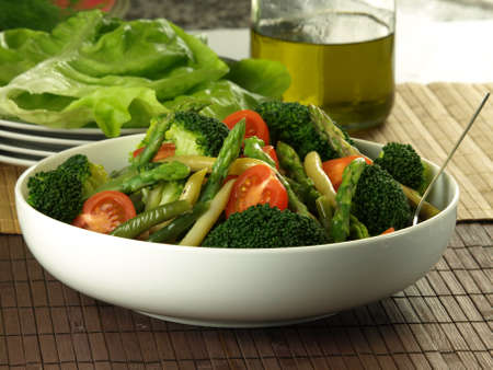 lowfat: Healthy salad with asparagus,broccoli,tomatoes and beans