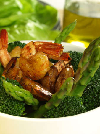 lowfat: Broccoli and asparagus with fried shrimps Stock Photo