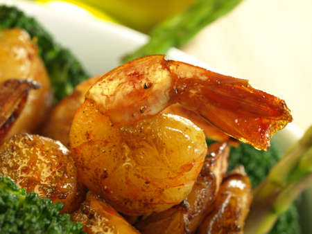 Fried shrimps with broccoli and asparagus photo