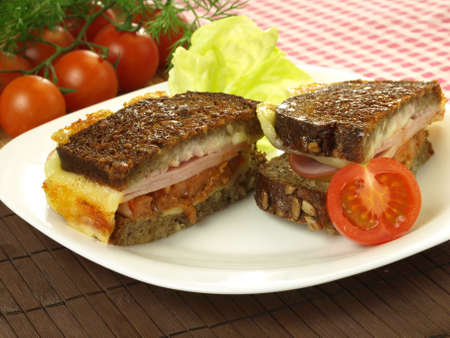 Grilled sandwich with cheese, ham and tomato photo