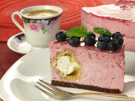 Raspberry dessert with blueberries and coffe photo