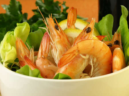 compound eyes: Shrimps in a salad with lettuce and lemon Stock Photo