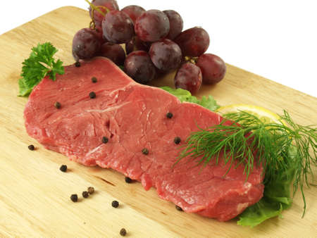 Raw beef meat with grapes photo