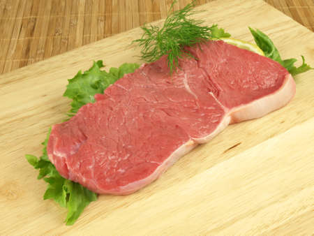 Raw beef with lettuce and dill Stock Photo - 12959428