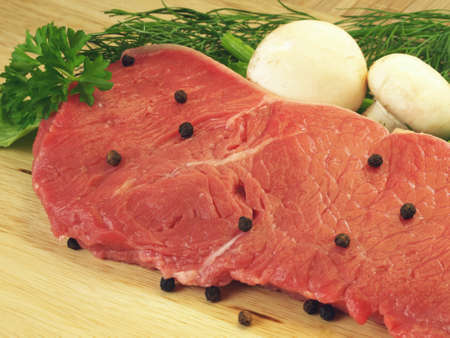 Raw beef meat with mushroons and dill